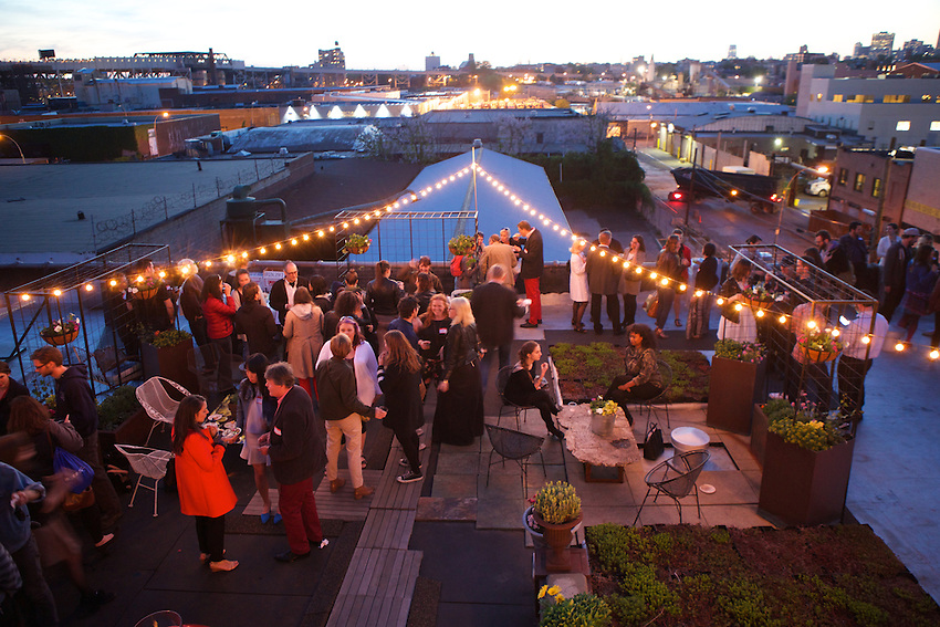 Brooklyn, NY - May 14, 2015: Heritage Radio Network hosted a rooftop party for contributors to the network's Kickstarter campaign at CMYK in Gowanus.<br /> <br /> <br /> CREDIT: Clay Williams for Heritage Radio Network.<br /> <br /> &copy; Clay Williams / claywilliamsphoto.com