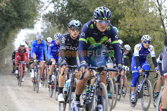 The peloton including Michal Kwiatkowski (POL) Team Sky on gravel sector 3 Radi during the 2017 Strade Bianche running 175km from Siena to Siena, Tuscany, Italy 4th March 2017.<br /> Picture: Eoin Clarke   Newsfile<br /> <br /> <br /> All photos usage must carry mandatory copyright credit (&copy; Newsfile   Eoin Clarke)