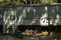 LEFT TO RIGHT: A memorial to Betty Mungin, 55; Alexis Mungin, 29 and her unborn twins; and her daughter Armani Mungin, 8 outside the trailer in Ravenel Mobile Home Park, where they were shot and killed in May 2016. Kenneth Lamar Ancrum, 23, faces 5 murder charges in their shooting deaths in RAVENEL, SC on Thursday, July 7, 2016. (Justin Cook)