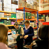 The store room inside Hammersmith and Fulham food bank in Christ Church, Fulham. Volunteers meet customers, offering a hot drink and cake before an interview is carried out to assess the person's needs. After this specially-selected bags of food are made up. Many food banks are run in or by local churches though not all volunteers at this bank would describe themselves as regular church goers.