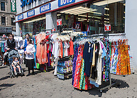 Racks of clothing outside a women's clothing store in the busy Graham Avenue CBD in the Bushwick neighborhood of Brooklyn in New York on Sunday, June 2, 2013. As more and more hipsters move into the neighborhood the ethnicity of the area is changing.   (© Richard B. Levine)