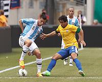 Argentina midfielder Jose Sosa (8) dribbles as Brazil defender Rafael Silva (2) pressures. In an international friendly (Clash of Titans), Argentina defeated Brazil, 4-3, at MetLife Stadium on June 9, 2012.