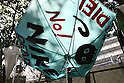 "Apr 18, 2010 - Tokyo, Japan - An umbrella used as a placard is set up by homeless and protesters to hinder the renovation of Miyashita Park in Shibuya Ward, Tokyo, Japan, on April 18, 2010. Under the plan, the sporting goods maker Nike Inc., which bought the right to name the park from the ward for ¥17 million annually for 10 years, will renovate two existing courts for ""futsal,"" a variant of soccer, and build rock climbing facilities and skateboard ramps."