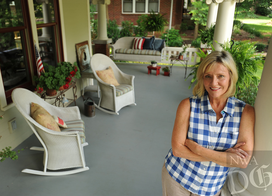 NWA Democrat-Gazette/ANDY SHUPE<br /> Talya Tate Boerner, a writer who writes for the blog gracegritsgarden.com, lives in a house on North Washington Avenue in Fayetteville. Her favorite space in her historic home is her front porch. Friday, June 26, 2015.
