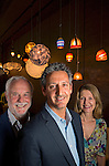 Gregory Frehling with his parents Robert and Nancy Frehling at Oggetti Designs and the Oggetti lighting collection in the Miami Design District