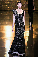 Tallulah Morton walks runway in a black tulle & chiffon gown, from the Badgley Mischka Fall 2011 fashion show, during Mercedes-Benz Fashion Week Fall 2011.