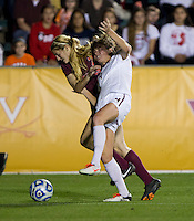 Kassey Kallman (9) of Florida State fights for the ball with Ellie Zoepfl (7) of Virginia Tech during the Women's College Cup semifinals at WakeMed Soccer Park in Cary, NC. Florida State defeated Virginia Tech, 3-2.