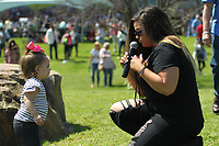 HOT SPRINGS, AR - MARCH 18: A Singer entertains a little girl in the infield before the running of the Rebel Stakes at Oaklawn Park on March 18, 2017 in Hot Springs, Arkansas. (Photo by Justin Manning/Eclipse Sportswire/Getty Images)