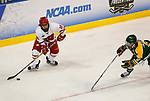 ST CHARLES, MO - MARCH 19:  Abby Roque (18) of the Wisconsin Badgers looks to center the puck during the Division I Women's Ice Hockey Championship held at The Family Arena on March 19, 2017 in St Charles, Missouri. Clarkson defeated Wisconsin 3-0 to win the national championship. (Photo by Mark Buckner/NCAA Photos via Getty Images)