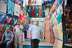 A shopkeeper sells traditional Tunisian clothing in the Medina (old city) in Tunis.