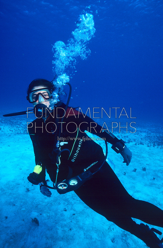 DIVERS<br /> Regulator, gauges &amp; dive computer<br /> Diver wearing scuba diving equipment underwater.