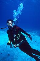 DIVERS<br /> Regulator, gauges &amp; dive computer<br /> Diver wearing scuba diving equipment underwater.