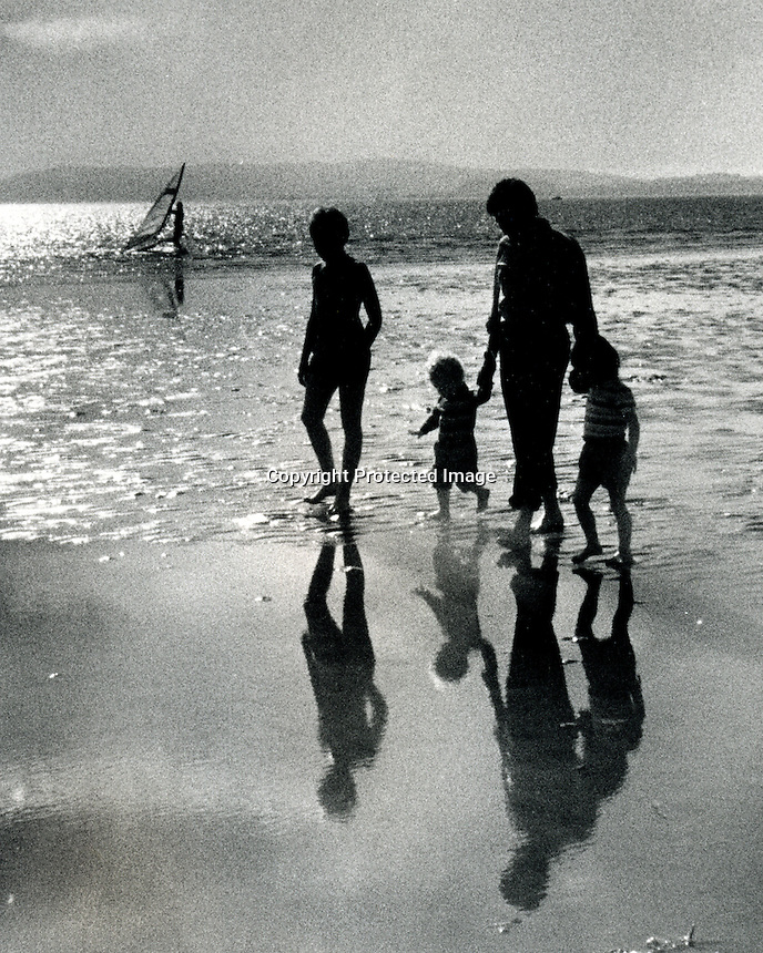 Getting their feet wet along the Alameda South Shore Park in Alameda, Ca on the edge of San Francisco Bay. .(1985 photo by Ron Riesterer)