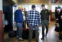 Border Patrol Checking for Undocumented Immigrant at a Greyhound Bus Station in Phoenix, AZ..Photo by AJ Alexander