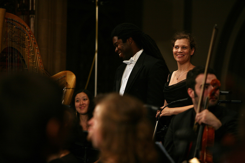 Baritone Dashon Burton and Soprano Jolle Greenleaf react to the audience's applause during Remember to Love: Let Us Love One Another With A Sincere Heart, an observation of the 10th Anniversary of September 11 at Trinity Church in Manhattan, NY on September 09, 2011. The six choirs performing include NYC Master Chorale, Trinity Choir, Young People's Chorus of New York City, The Washington Chorus, The Bach Choir of Bethlehem and The Copley Singers.