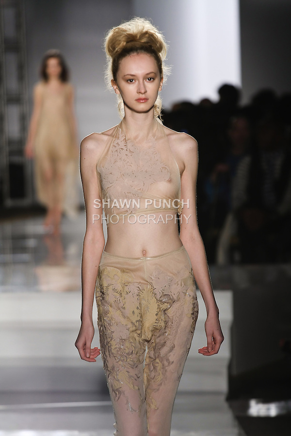 Model walks runway in an outfit by Myrtle Quillamor, for the Parsons 2011 BFA Fashion Show, hosted by Reed Krakoff.