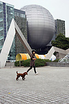 Photo shows the planetarium museum inside the metropolitan science museum in Nagoya, Aichi Prefecture, Japan on 13 Oct. 2011. Photograph: Robert GilhoolyA woman walks her dog through the grounds of  the park behind the city science museum in Nagoya, Aichi Prefecture, Japan on 13 Oct. 2011. Photograph: Robert Gilhooly