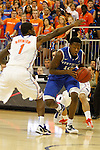UK freshman guard Archie Goodwin under defense by UF senior guard Kenny Boynton during the first half of the University of Kentucky vs. University of Florida men's basketball game at the O'Connell Center in Gainesville, Fl., on Tuesday, February 12, 2013. Photo by Tessa Lighty | Staff
