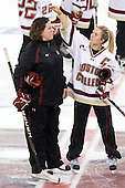 Kelli Stack (BC - 16) fixes Courtney Kennedy's (BC - Assistant Coach) hair.