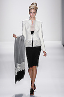 Model walks runway an IVORY ITALIAN SILK DUPIONI SCULPTED  PRINCESS JACKET BORDERED W/ FRENCH LACE +RIBBON EBONY ITALIAN SILK DUPM HIGH WAISTED, PENCIL SKIRT by Zang Toi, for the Zang Toi Spring 2012 My Dream Of North Africa Collection, during Mercedes-Benz Fashion Week Spring 2012.
