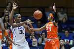 18 January 2015: Duke's Amber Henson (30) throws the ball away from Miami's Adrienne Motley (23). The Duke University Blue Devils hosted the University of Miami Hurricanes at Cameron Indoor Stadium in Durham, North Carolina in a 2014-15 NCAA Division I Women's Basketball game. Duke won the game 68-53.