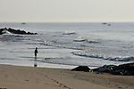 A young boy fishes on the beach in Ocean Grove,  New Jersey. Photo By Bill Denver/EQUI-PHOTO