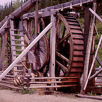 Barkerville, a Restored Historic Gold Rush Town in the Cariboo Region, BC, British Columbia, Canada - 1870s Cornish Water Wheel used in searching for Gold