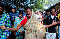 Shirina Begum cries after her daughter, her only other family member died in the blaze. At least 112 people died, and more than 100 were injured at a fire at the Tazreen Fashions textile factory in Dhaka. Bangladesh's garment industry has a notoriously bad fire safety record; if the right precautions had been taken, the fire could have been prevented.