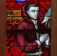 Chancellor Rolin, 1376-1462, with his coat of arms, detail from the stained glass window, 15th century, in the Chapel, in the Salle des Povres or Room of the Poor, in Les Hospices de Beaune, or Hotel-Dieu de Beaune, a charitable almshouse and hospital for the poor, built 1443-57 by Flemish architect Jacques Wiscrer, and founded by Nicolas Rolin, chancellor of Burgundy, and his wife Guigone de Salins, in Beaune, Cote d'Or, Burgundy, France. The hospital was run by the nuns of the order of Les Soeurs Hospitalieres de Beaune, and remained a hospital until the 1970s. The building now houses the Musee de l'Histoire de la Medecine, or Museum of the History of Medicine, and is listed as a historic monument. Picture by Manuel Cohen