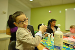 Patients and care givers at NYU's Hassefeld clinic.<br /> Photos for the Making Headway Foundation.
