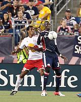 New England Revolution midfielder Saer Sene (39) controls the ball as New York Red Bulls defender Roy Miller (7) pressures. In a Major League Soccer (MLS) match, New England Revolution defeated New York Red Bulls, 2-0, at Gillette Stadium on July 8, 2012.