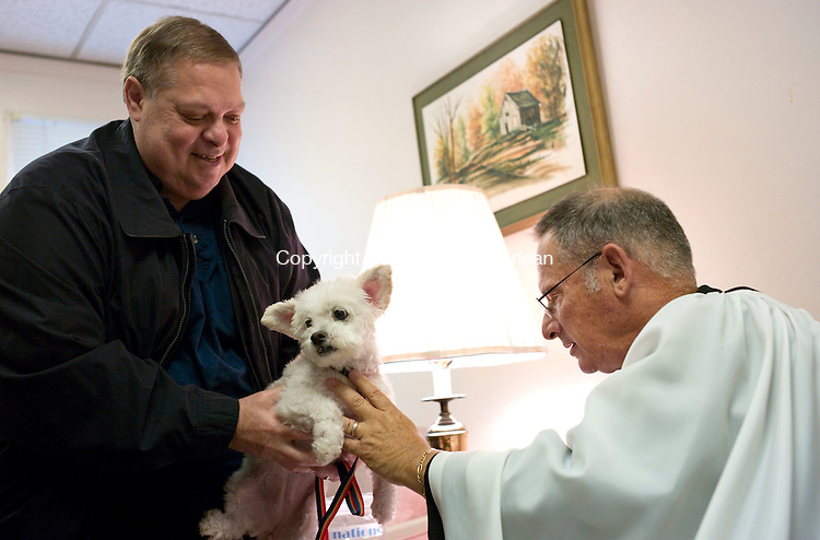 Middlebury, CT- 03 October 2015-100315CM04- ​ ​<br /> Steve Ferrucci of Middlebury has Molly a mixed breed blessed by The Reverend Andrew Zeman at St. George's Episcopal Church in Middlebury on Saturday.     Christopher Massa Republican-American