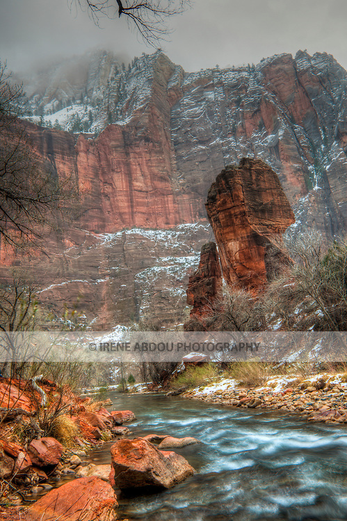 The North Fork of the Virgin River rushes past the Temple of Sinawava,  one of many spectacular rock formations in southern Utah's famed Zion National Park.