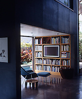 To one side of the main living space is a smaller room for televisiona and reading