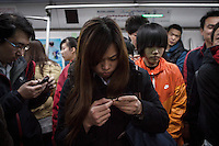 Commuters inside Beijing Metro.