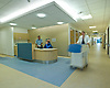 hospital corridor and reception desk with three people. Interior.