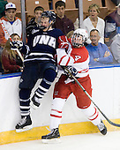 Damon Kipp (UNH - 4), Will Weber (Miami - 4) - The University of New Hampshire Wildcats defeated the Miami University RedHawks 3-1 (EN) in their NCAA Northeast Regional Semi-Final on Saturday, March 26, 2011, at Verizon Wireless Arena in Manchester, New Hampshire.