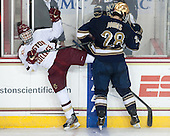 Johnny Gaudreau (BC - 13), Stephen Johns (ND - 28) - The visiting University of Notre Dame Fighting Irish defeated the Boston College Eagles 7-2 on Friday, March 14, 2014, in the first game of their Hockey East quarterfinals matchup at Kelley Rink in Conte Forum in Chestnut Hill, Massachusetts.