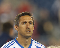 Montreal Impact midfielder Davy Arnaud (22). In a Major League Soccer (MLS) match, Montreal Impact (white/blue) defeated the New England Revolution (dark blue), 4-2, at Gillette Stadium on September 8, 2013.