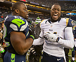 St. Louis Rams  defensive back Maurice Alexander and Seattle Seahawks running back Robert Turbin (22) joke around while trading jerseys  after their game at CenturyLink Field in Seattle, Washington on December 28, 2014.  The Seahawks officially wrapped up the No. 1 seed in the NFC playoffs shortly after beating the Rams, 20-6. Despite the Cowboys and Packers also winning to finish 12-4, the Seahawks (12-4) won the multi-team tiebreaker and earned home-field advantage throughout the playoffs for the second consecutive season.  ©2014. Jim Bryant Photo. All Rights Reserved.