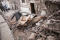 Thuesday 09 July, 2015: A resident collects his belongings from the rubble of his house that was among the historial site of residential tower-houses obliterated by a bomb after they were targeted, accordingly with witnesses, by a fighter jet of the Saudi-led coalition in the old city of Sana'a last June 12, 2015. Five residents were killed and four house-buildings reduced to rubble during the early-morning attack that endangered the 2,500-year-old cultural heritage site. The attack, condemned by the international community, is part of the campaign of bombardments by the coalition of Arab states and their western allies led by Saudi Arabia to tackle the Houthi insurgency that removed from power to the former president Abd Rabbuh Mansur Hadi. (Photo/Narciso Contreras)