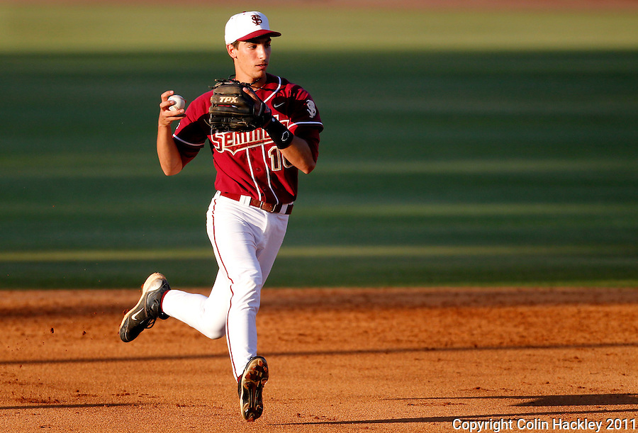 TALLAHASSEE, FL 4/12/11-FSU-UF BASE11 CH-Florida State's Justin Gonzalez lines up a throw to first base against Florida during action Tuesday at Dick Howser Stadium in Tallahassee. The Seminoles beat the Gators 3-1. COLIN HACKLEY PHOTO