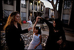 Zulayka Martinez coverted to Islam from Catholicism. Here she celebrates a family baptism. Houston, Texas, USA, November, 2002