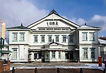 Photo shows the Western-style exterior of the Korakukan theater, Japan's oldest extant wooden playhouse in Kosaka, Akita Prefecture Japan on 19 Dec. 2012. Made entirely from wood, the theater was opened in 1910 and was registered as an Important Cultural Property in 2007. Today it attracts around 56,000 visitors during its 8-month season. Photographer: Robert Gilhooly