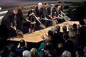 Participants break ground at the groundbreaking of the Smithsonian National Museum of African American History and Culture in Washington, D.C. on Wednesday, February 22, 2012. The museum is scheduled to open in 2015 and will be the only national museum devoted exclusively to the documentation of African American life, art, history and culture. Pictured, from left to right: Richard Parsons, Co-chair of the National Museum of African American History and Culture Council;  Patty Stonesifer, Smithsonian Board of Regents; former first lady Laura Bush; Wayne Clough, Secretary, Smithsonian Institution; Lonnie Bunch, Director, Smithsonian Museum; Smithsonian Undersecretary for History, Art and Culture Richard Kurin; France Cordova, Chair, Smithsonian Board of Regents; and Linda Johnson Rice, Co-chair of the National Museum of African American History and Culture Council. .Credit: Andrew Harrer / Pool via CNP