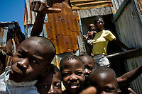 Haitian children play joyfully in the slum of Cité Soleil, Port-au-Prince, Haiti, 11 July 2008. Cité Soleil is considered one of the worst slums in the Americas, most of its 300.000 residents live in extreme poverty. Children and single mothers predominate in the population. Social and living conditions in the slum are a human tragedy. There is no running water, no sewers and no electricity. Public services virtually do not exist - there are no stores, no hospitals or schools, no urban infrastructure. In spite of this fact, a rent must be payed even in all shacks made from rusty metal sheets. Infectious diseases are widely spread as garbage disposal does not exist in Cité Soleil. Violence is common, armed gangs operate throughout the slum.