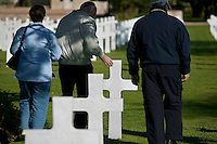 24 April 2004 - Coleville-sur-Mer, France - Visitors from Minneapolis, USA, walk through the American military cemetary of Coleville-sur-Mer, France, 24 April 2004.