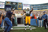 Reggie White is introduced to the fans at the start of the game against the Chargers.