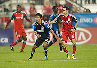 27 August 2011: San Jose Earthquakes midfielder Rafael Baca #30 and TorontoFC midfielder Eric Avila #8 in action during a game between the San Jose Earthquakes and Toronto FC at BMO Field in Toronto..The game ended in a 1-1 draw.