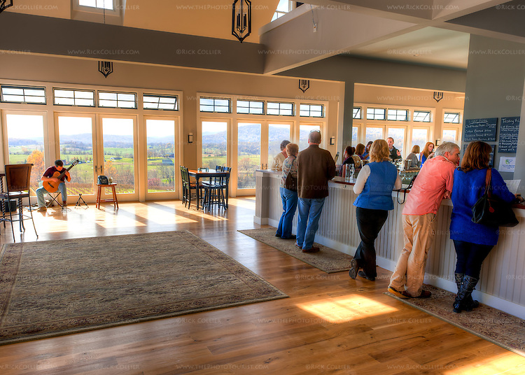 Customers crowd around the bar at Delaplane Cellars, enjoying the natural light, fabulous view, and live music on weekends.